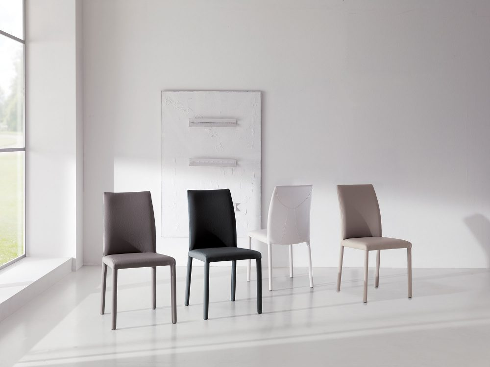 Chris Dining Chair Eco-Leather Upholstery has an Elegant Design and High Attention to Details.